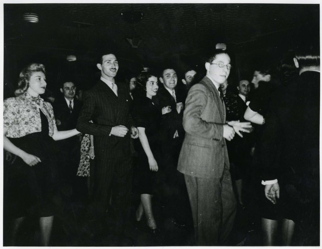 a photo of people in 1940s dress dancing together