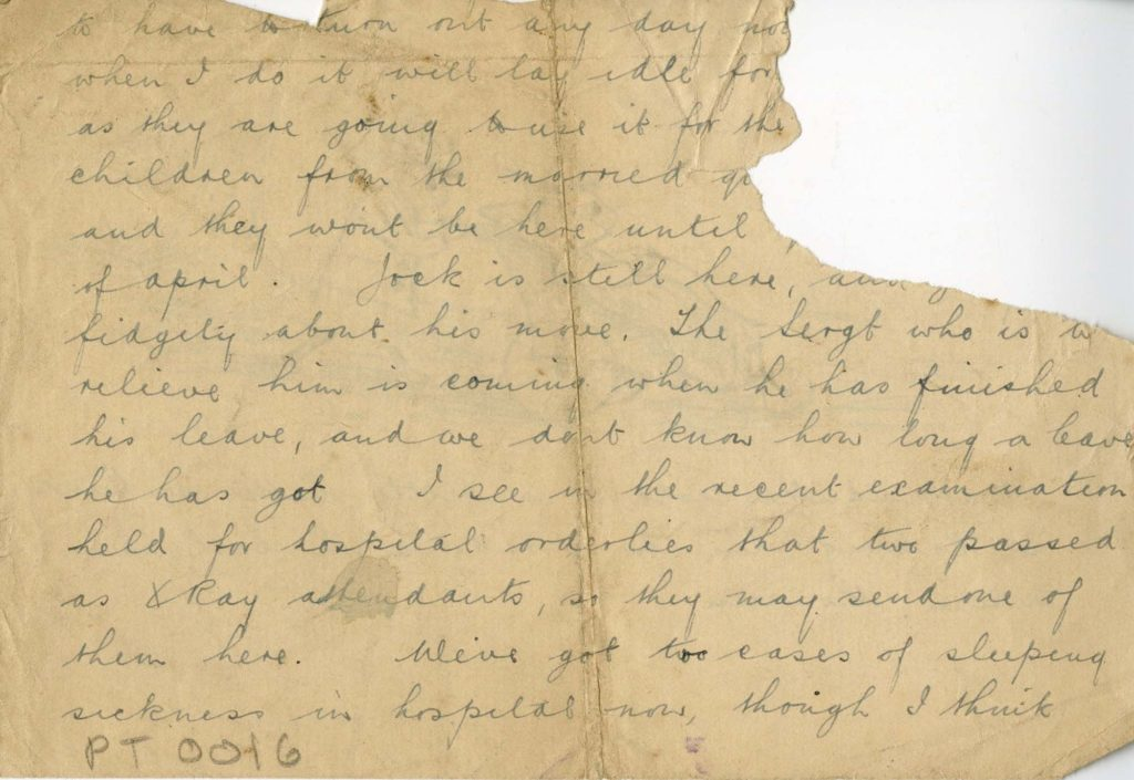 a photo of a handwritten letter with a tear in its corner