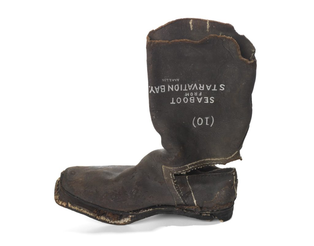 a photo of an old worn leather boot