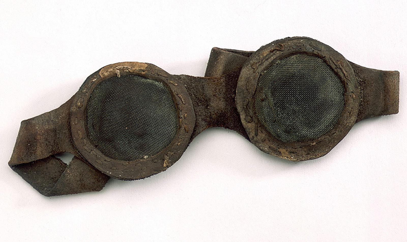 a photo of a pair of old goggles with wire mesh lenses