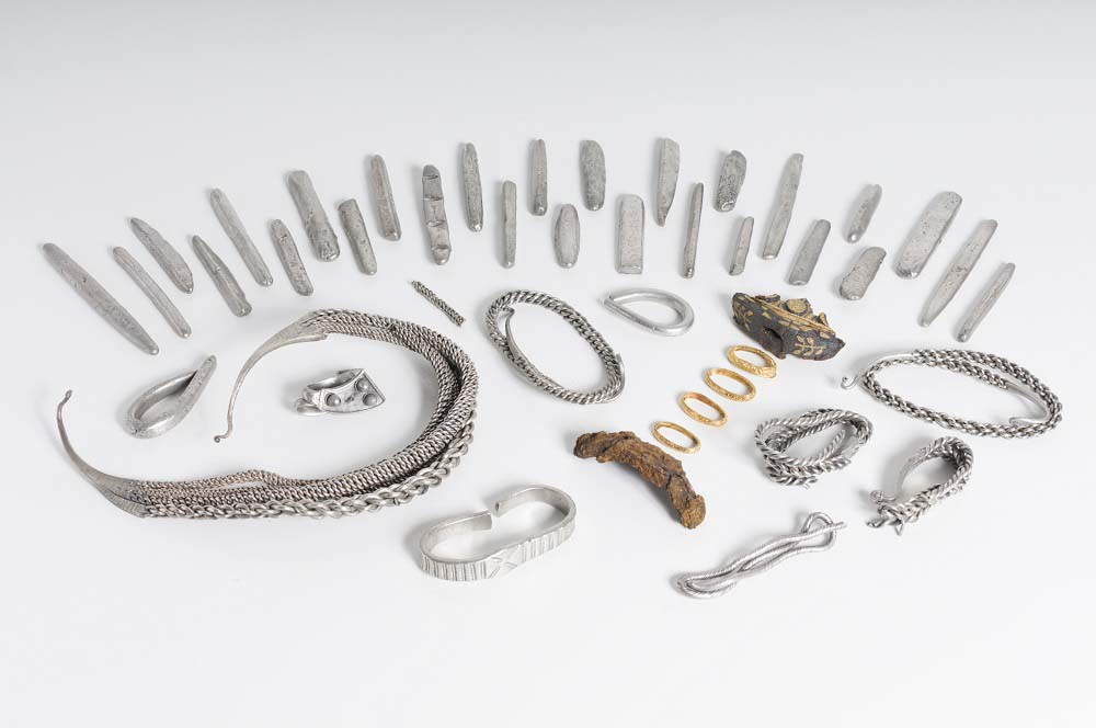 a photo of a hoard of ingots and bracelets