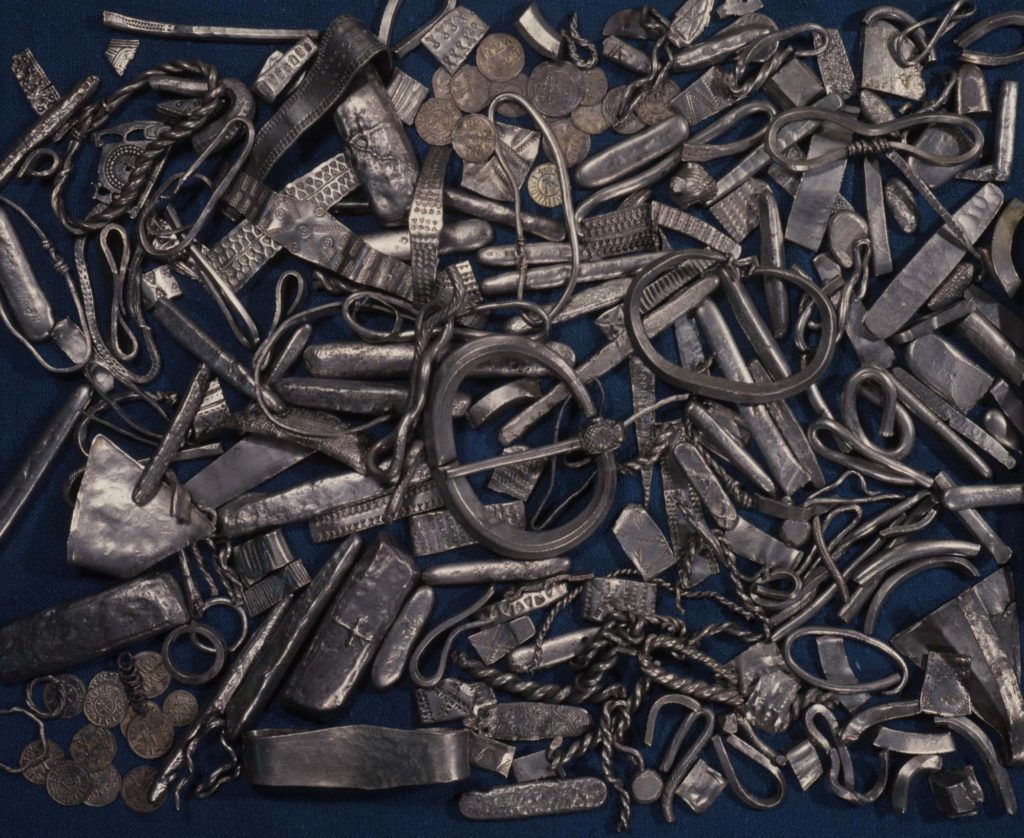 a photo of a haord of metal ingots and bracelets