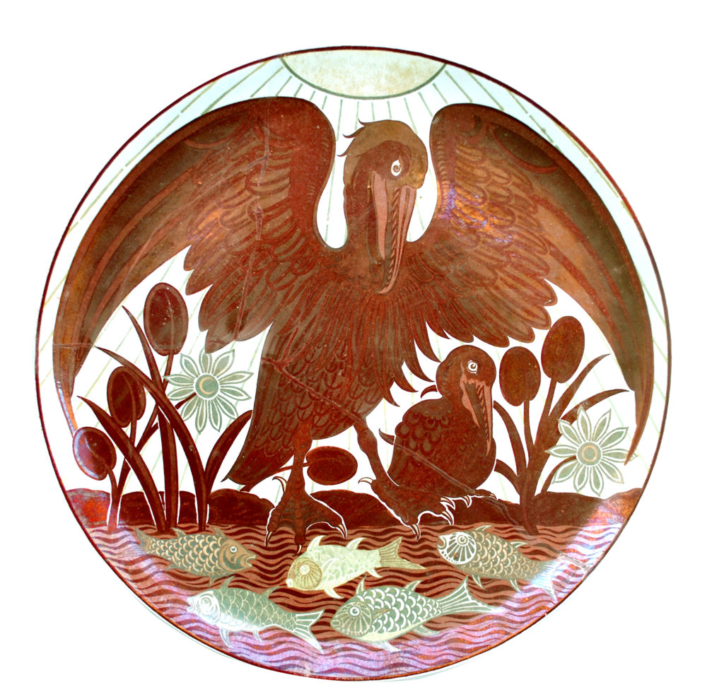 a round plate with a bird spreading its wings