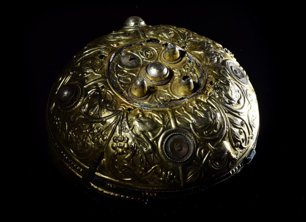 a photo of an embossed golden bowl