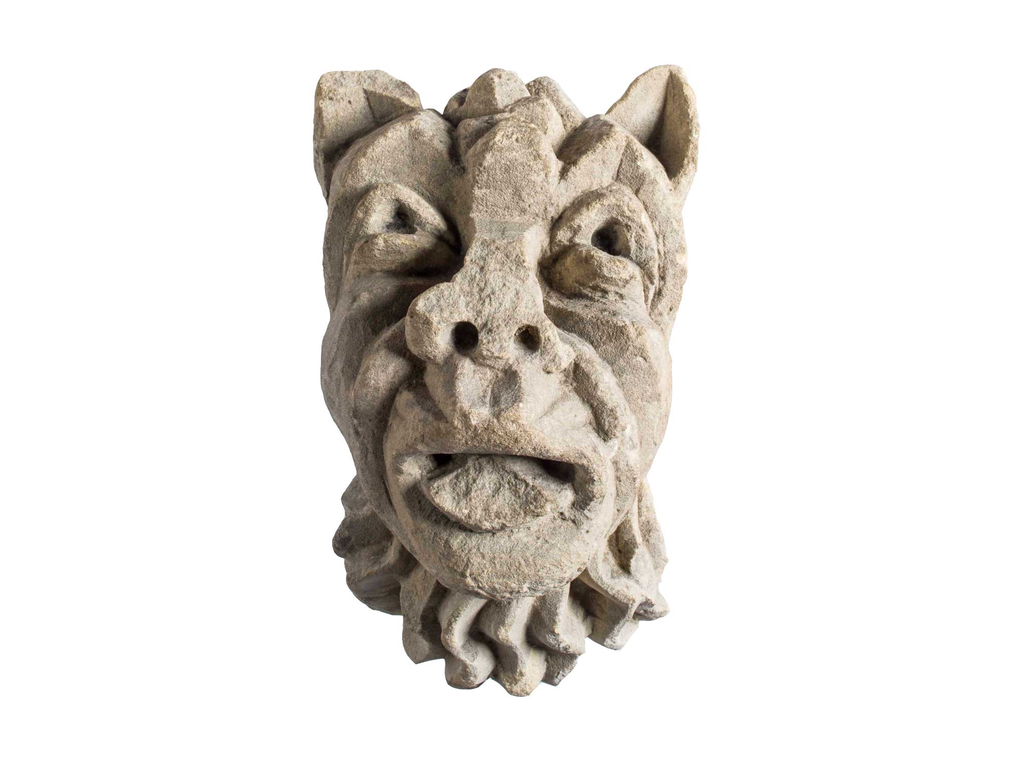 a carved stone gargoyle with pointed ears