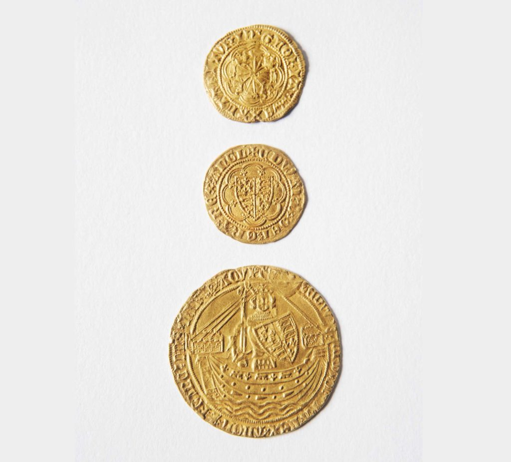 a scan of three medieval gold coins