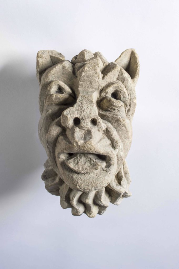 a stone carved head of an animal