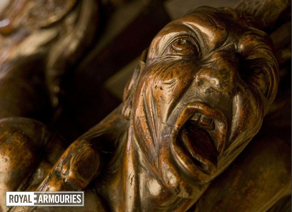 a detail of a carved screaming head
