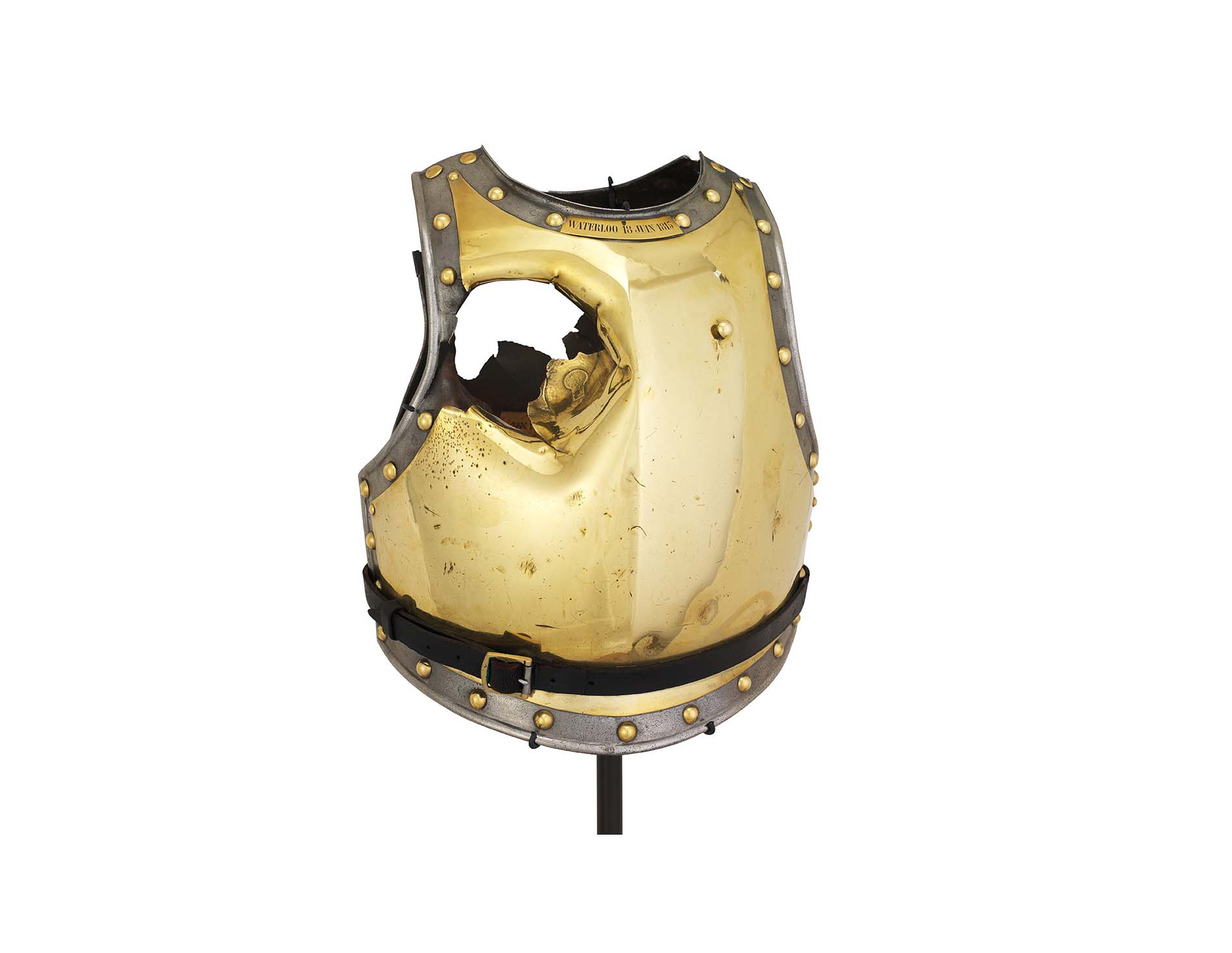 a photo of golden breastplate with a large hole punched through it