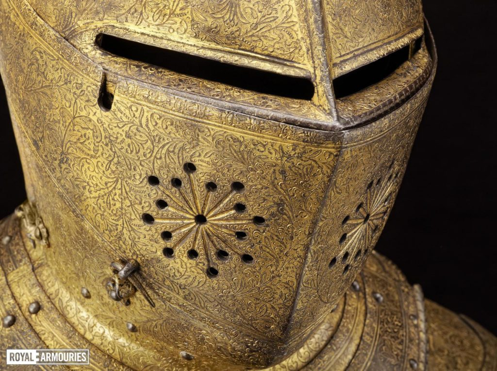 a gilded closed faced armoured helmet