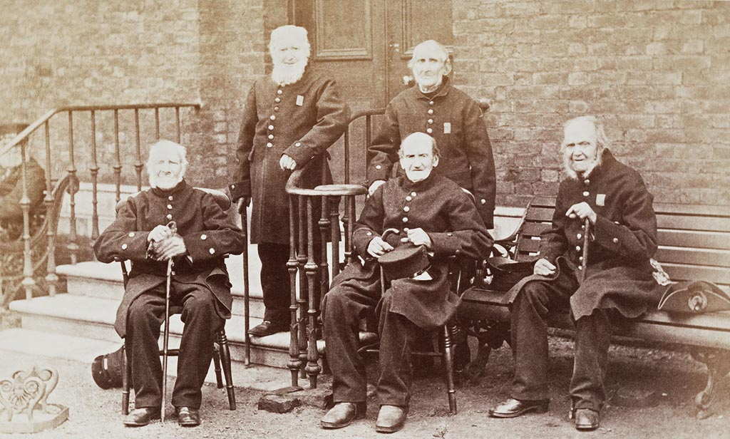 a black and white photo of a group of old soldiers