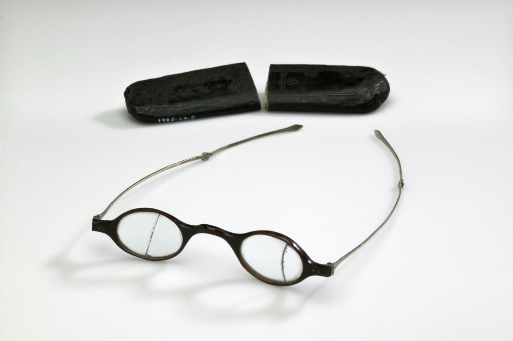 a photo of a pair of spectacles and case photograhed on a white background