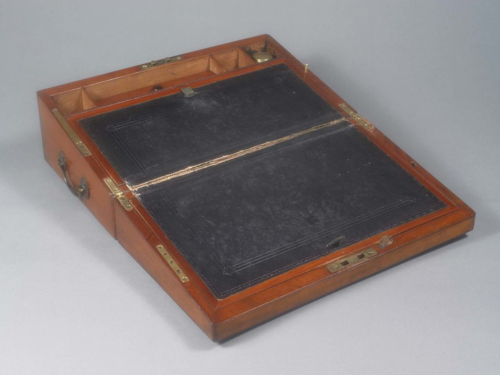 a photo of Jane Austen's writing slope open at its hinges with black inlay with