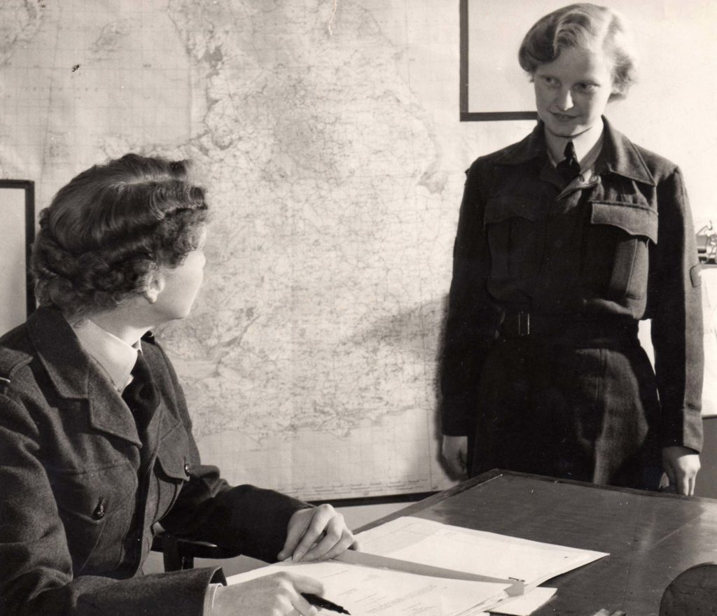 a photo of two women, ones seated, in RAF dress