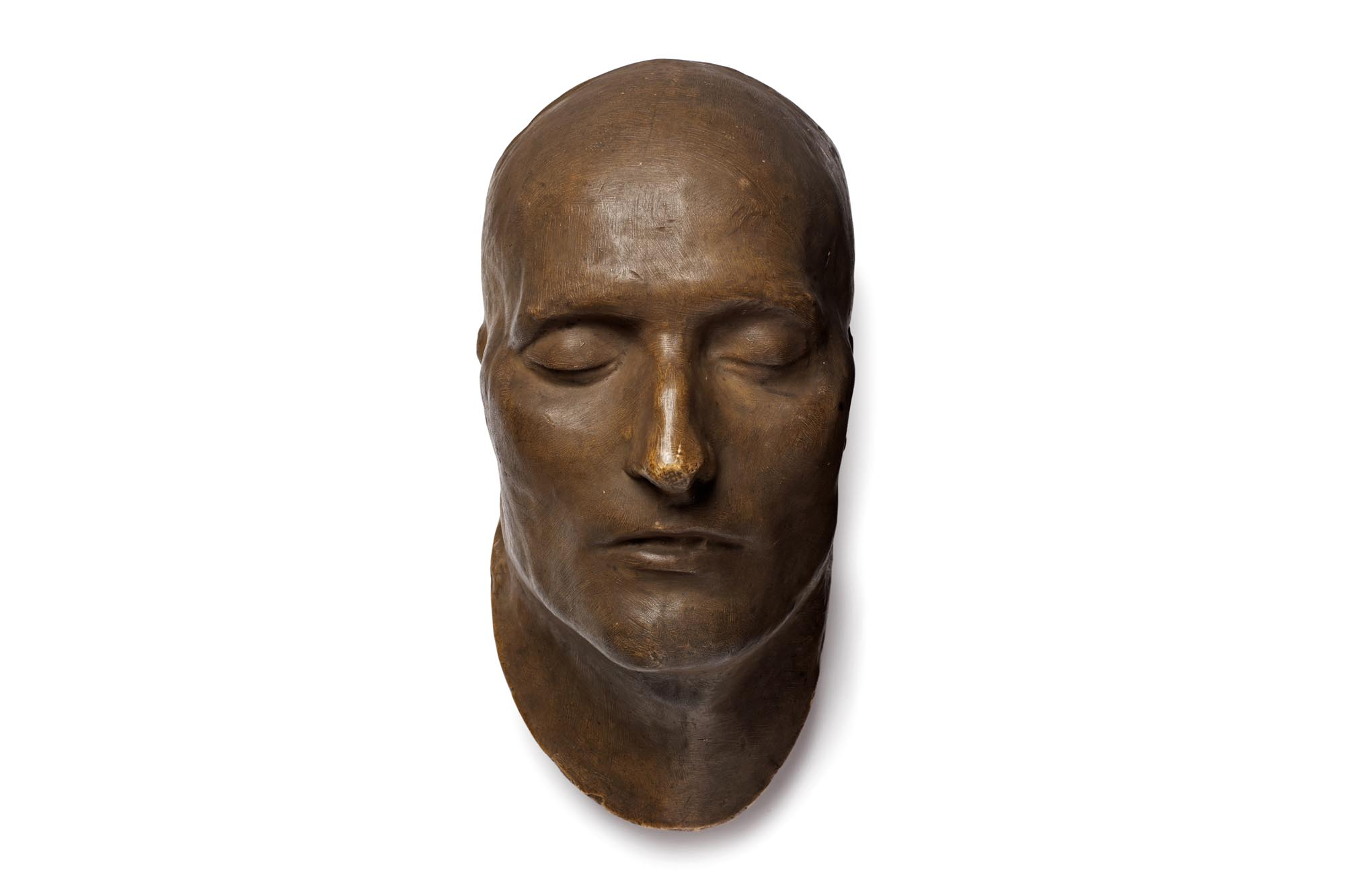 a photo of a death mask in brown