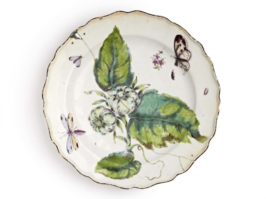 a photo of a porcelain plate with a crack across its centre