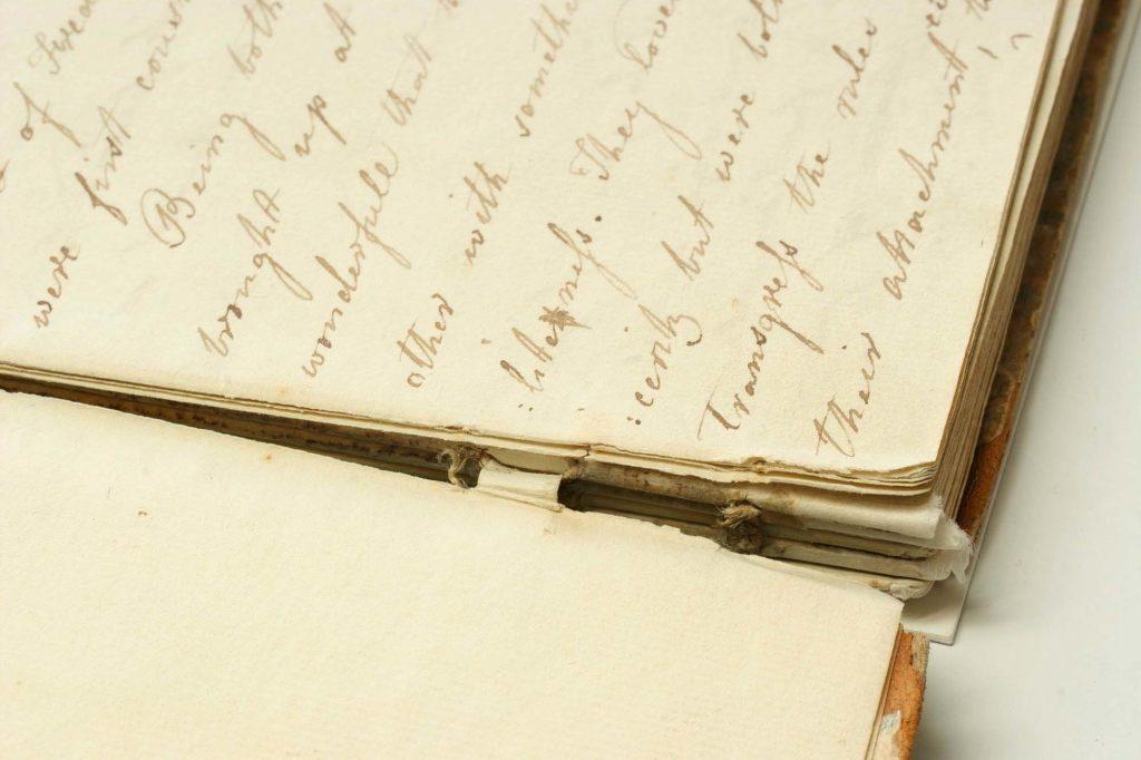 a close up of Jane Austen's handwritten stories