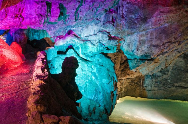a photo of a cavern lit flourescent lighting