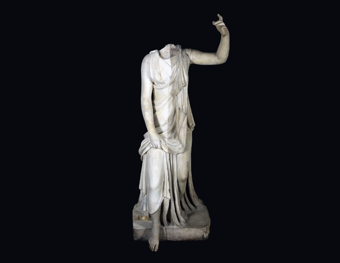 a photo of a classical female statue minus its head