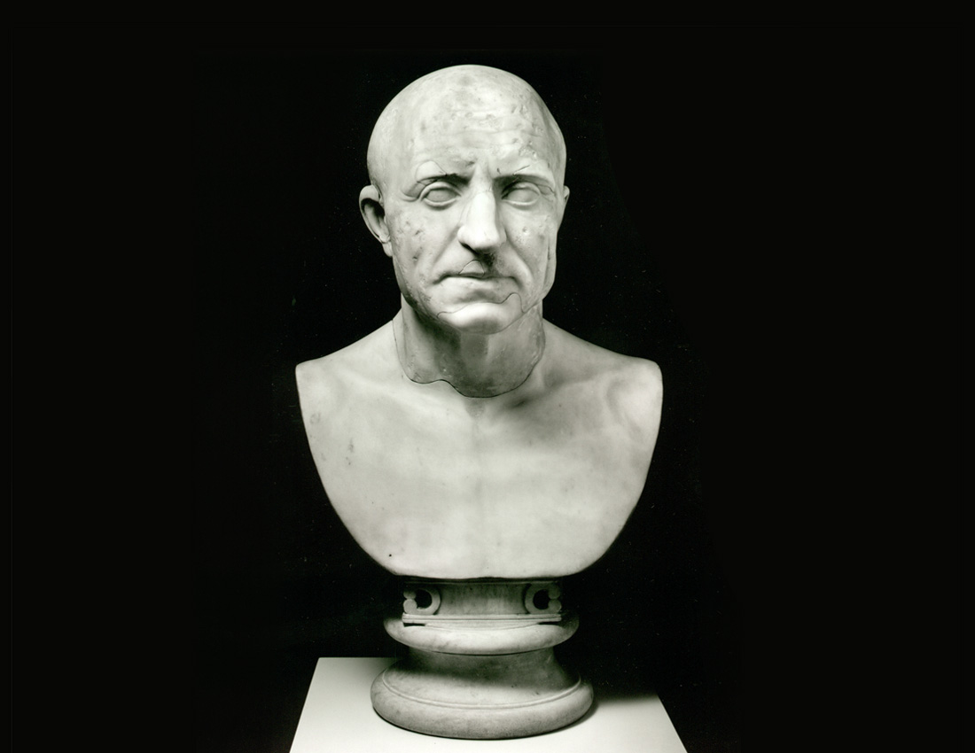 a carved bust of a middle-aged male