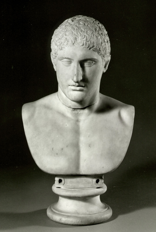a carved bust of a young man with short hair