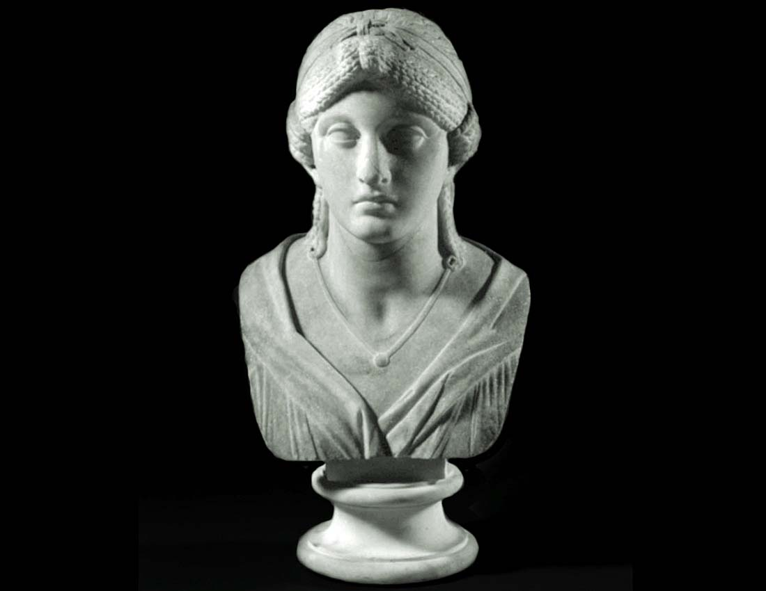 a carved bust of a young woman
