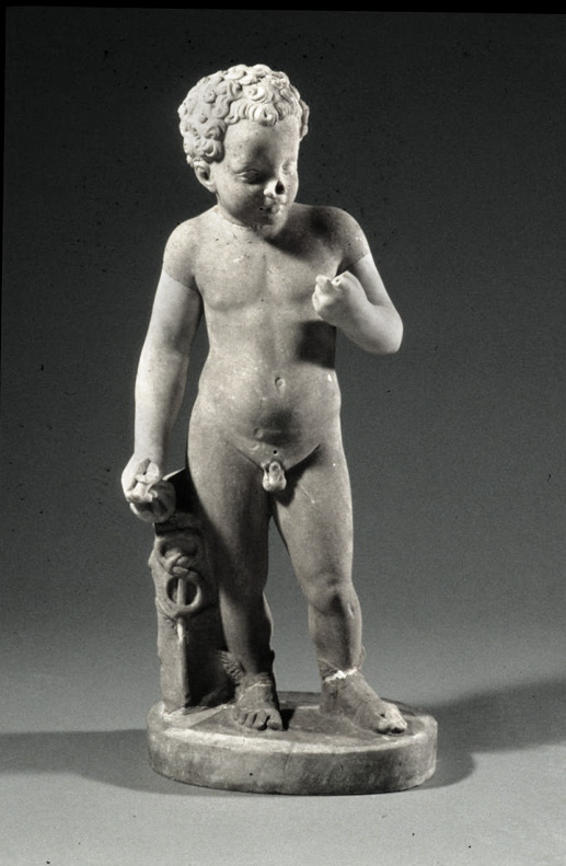 a craved statue of a young boy