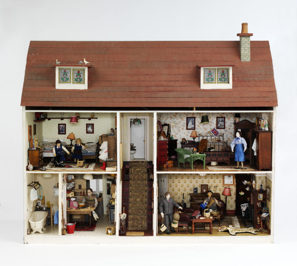 a photo of a dolls' house with the front open