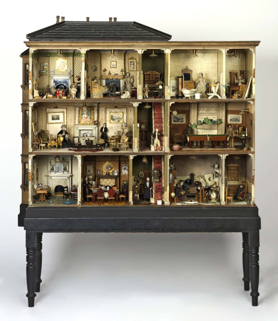 a photo of an ornate dolls house in the Victorian style