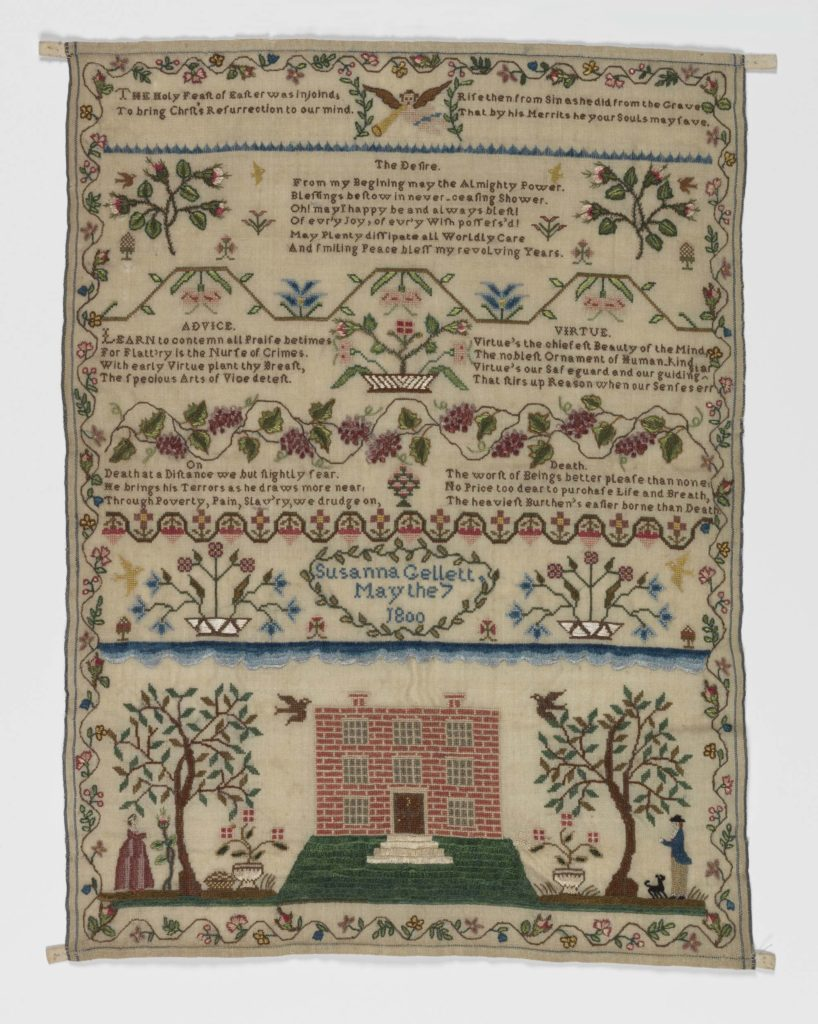 an embroidered sampler with trees and houses and other rural motifs