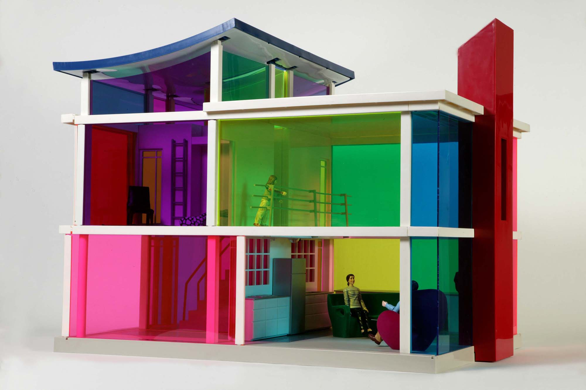 a photo of a modernist styled dolls house with flourescent see through walls