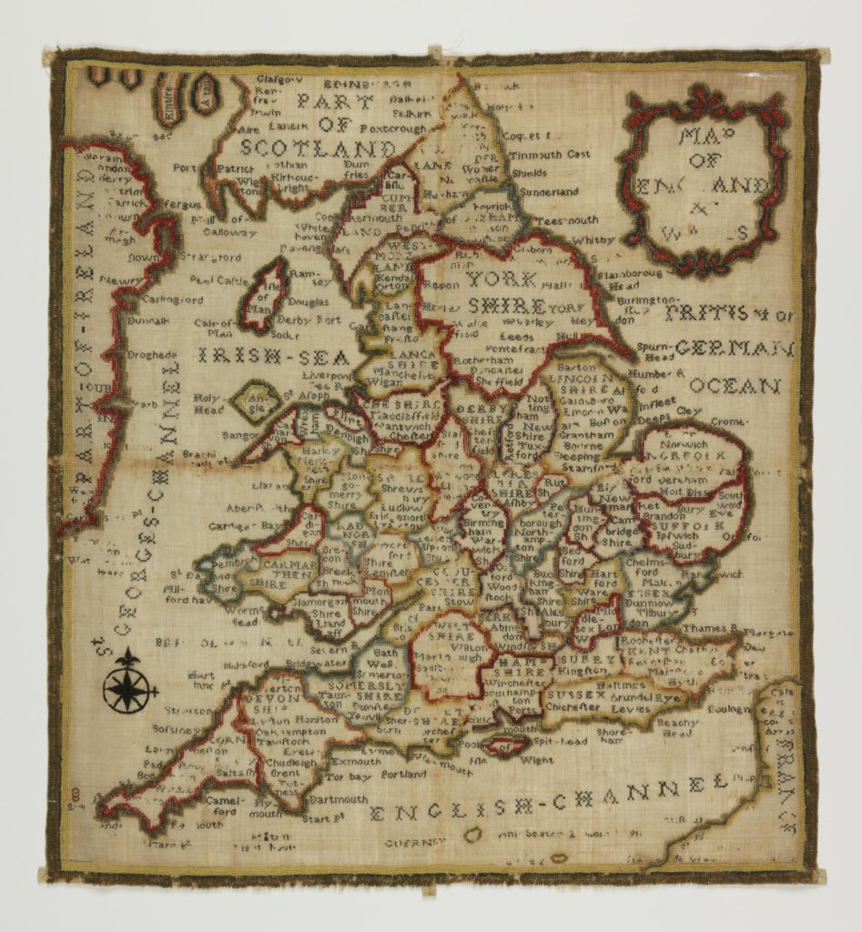 an embroidered sampler showing the map of England and Wales