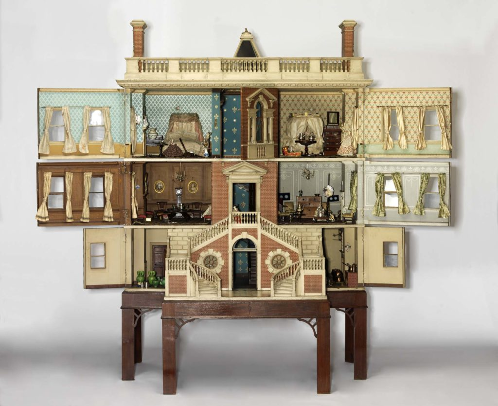 a photo of a 18th century styled dolls house open with