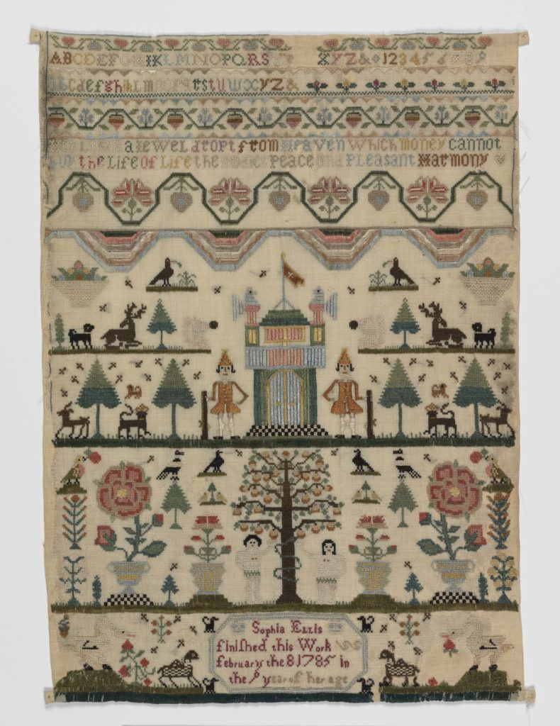an emboidered sampler with trees, a castle and other motifs