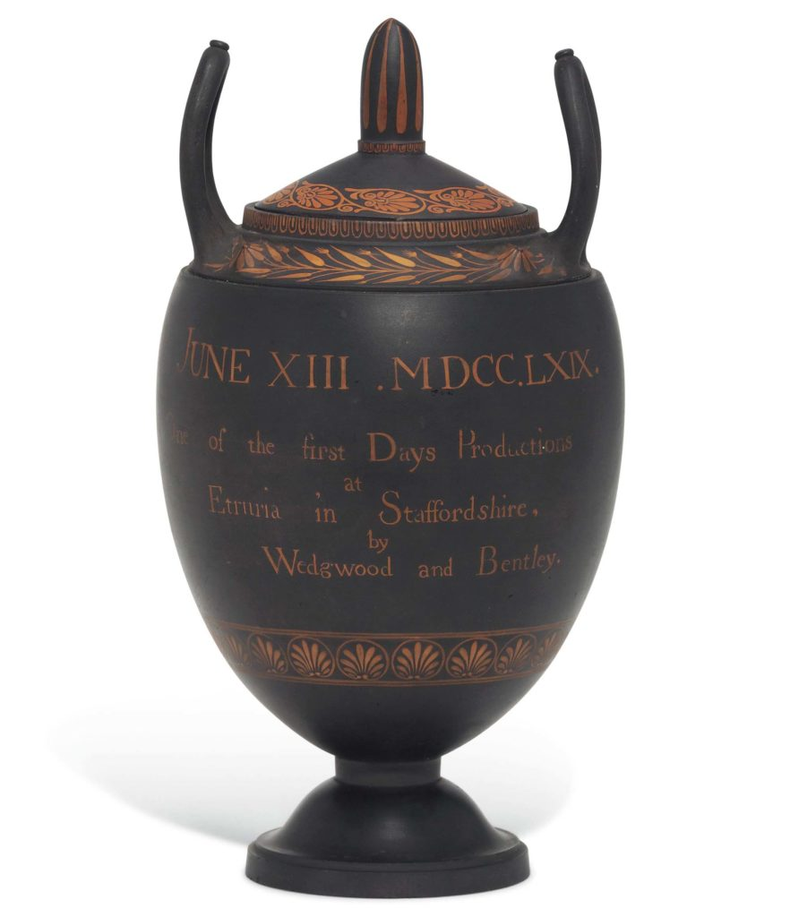a photo of a Greek-styled urn with inscription