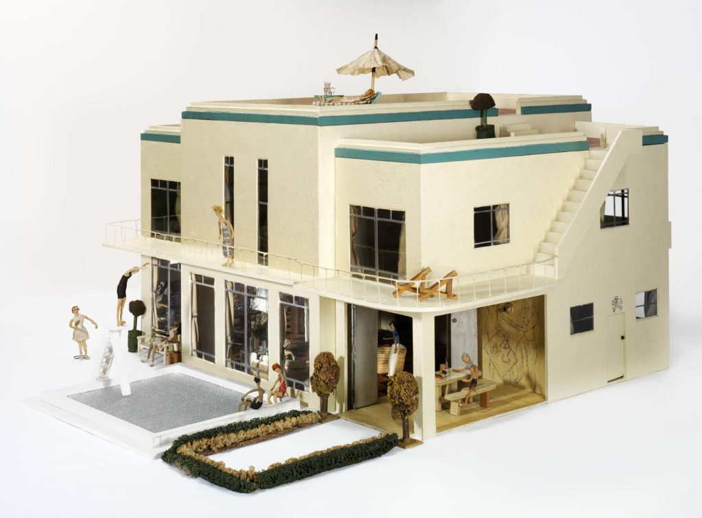 a photo of a white-painted Modernist dolls house