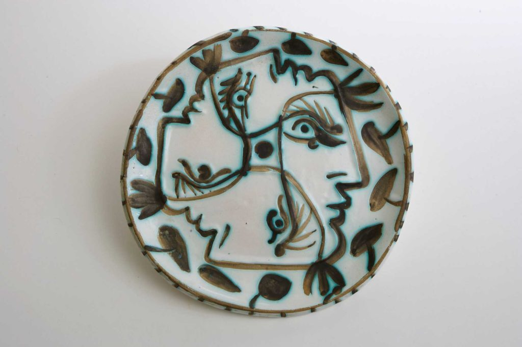 a photo of a plate by Picasso with a face in side profile