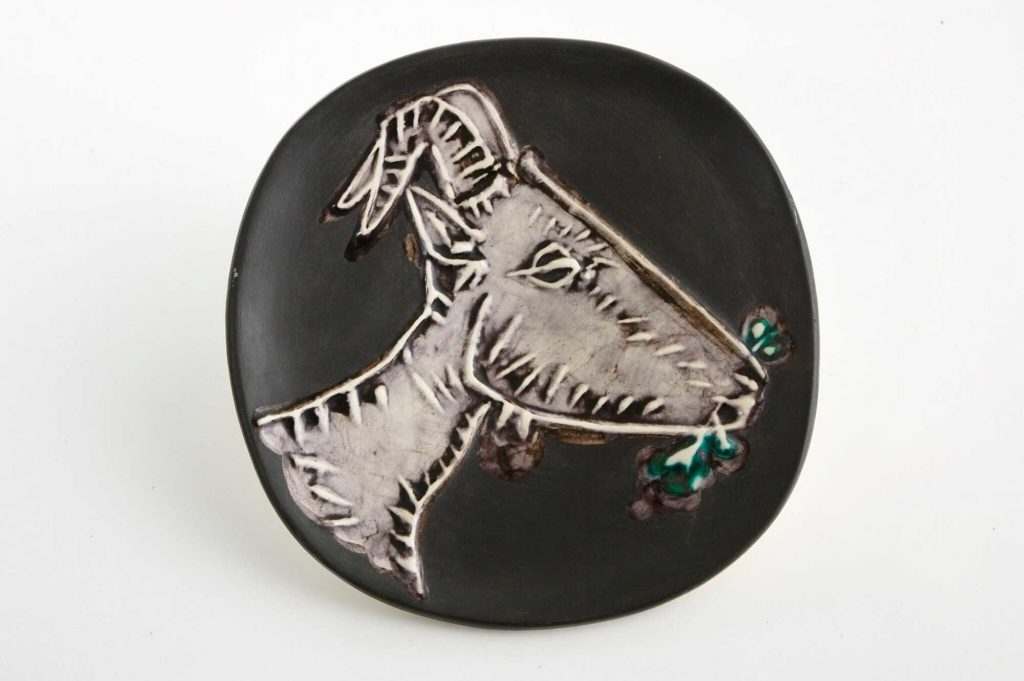 a photo of a ceramic dish by Picasso with the image of a goat on it