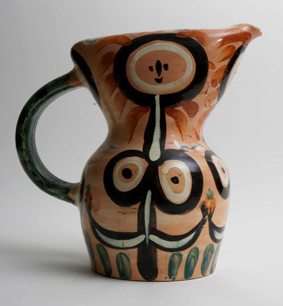 a photo of a handled jug by Picasso with a nude decoration