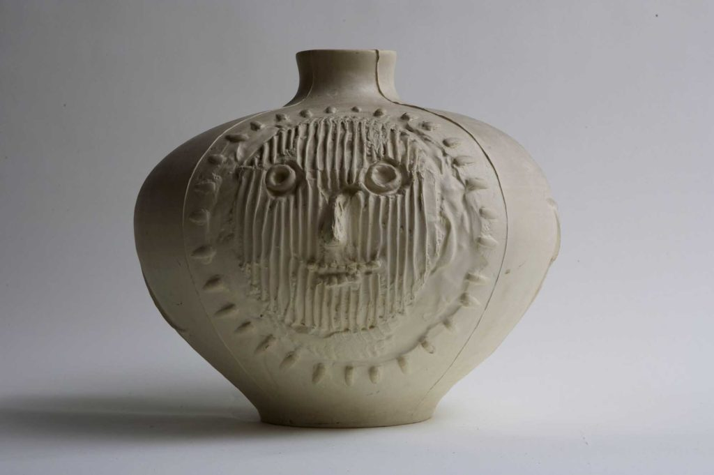 a photo of a squat pot by Picasso with a face scrawled into it
