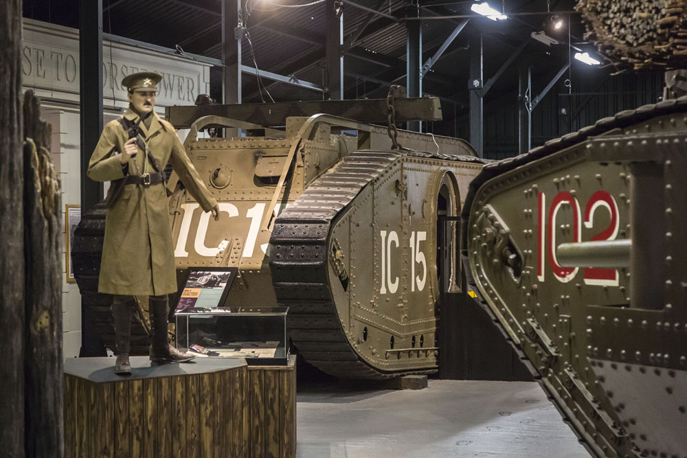 An image of a tank with an manequin dressed as an officer standing in front