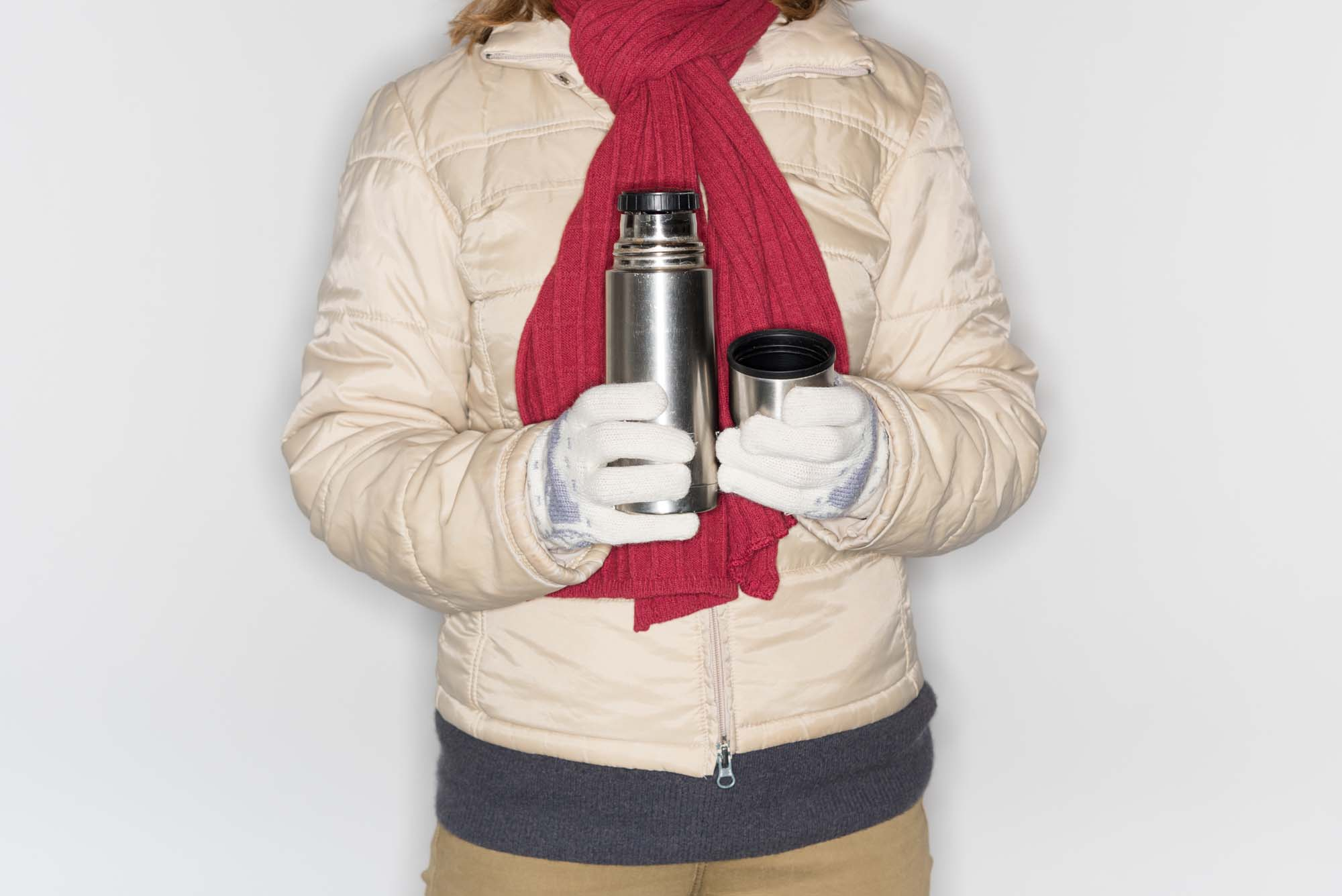 a cropped photo of someone holding a thermos flask