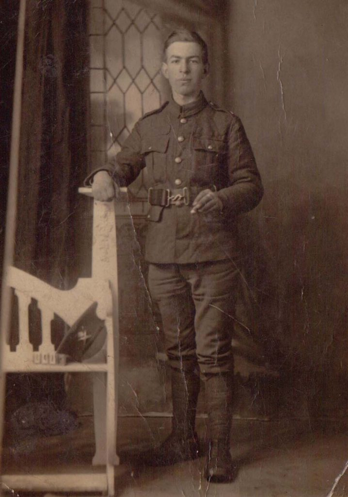 a photograph of a man in a First World War soldier's unifrom