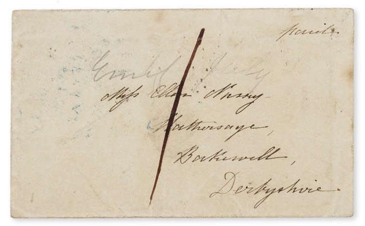 a photo of a torn handwritten envelope
