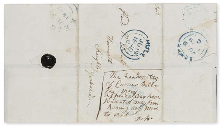 a photo of a postmarked envelope with an address and other scribblings on it