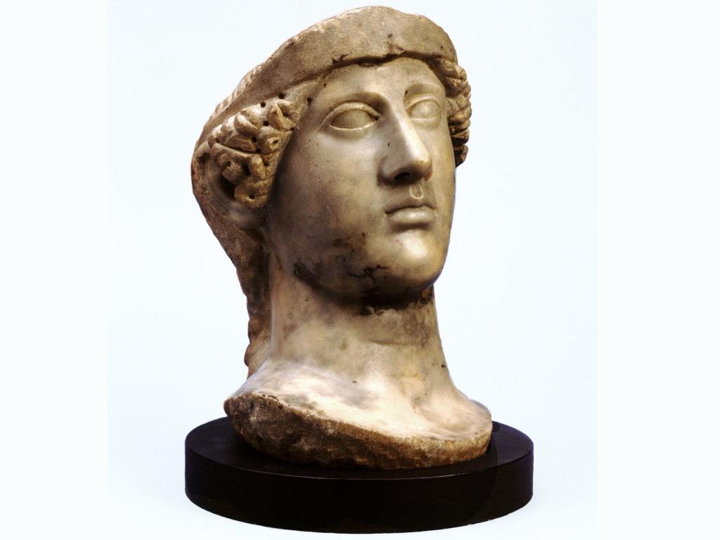 a sculpted head of a female figure