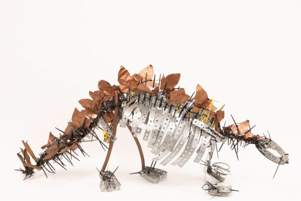 Image showing a stegosaurus constructed from found metal objects