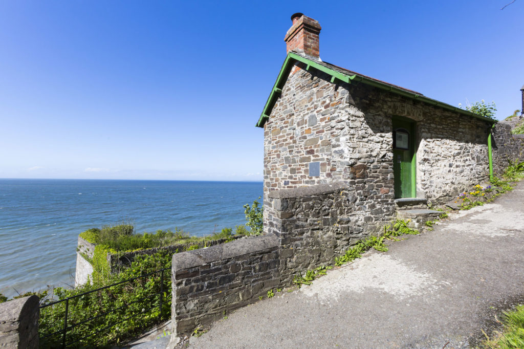 photograph of small cottage overlooking the sea