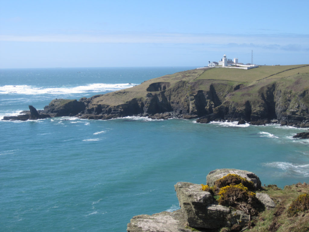 photograph of spit of land with lighthouse on top