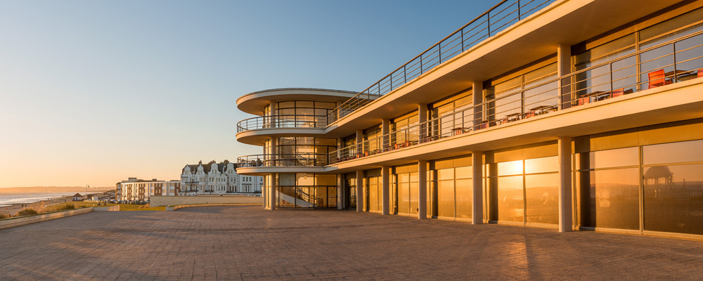 A shot of the pavillion at sunset, looking out over the beach